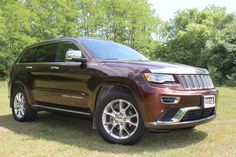 "2014 Jeep Grand Cherokee Summit 4x4 w/Quadra Lift Air Suspension Panoramic Sunroof w/ Power Sunshade, Heated Steering Wheel, Heated & Cooled Front Seats, Heated Rear Seats, Back Up Camera, Navigation, Bluetooth, Remote Start, Power Lift Gate, Power Tilt & Telescopic Steering Wheel, Forward Collision Warning, 3.6L V6, 8-Speed Automatic Transmission with Paddle Shift, 20"" Alloy Wheels, 4x4 with Selec-Terrain, Balance of Factory Warranty and only 41,420 kms – Deep Auburn Pearl  41,555 +tax or…"