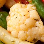 Steam or boil cauliflower and green beans 6-7 minutes, until tender; drain. Place in a large bowl, add soy sauce