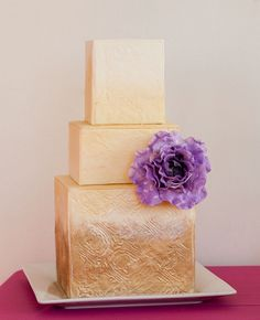 Photo by Kristy May Photography // http://blog.theknot.com/2013/09/05/glamorous-metallic-wedding-cakes/