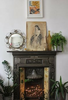At Home: Decorating With Plants....like the idea of the twinkle lights in fireplace