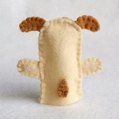 This is a PDF pattern for a dog finger puppet. The pattern contains step-by-step instructions and illustrations to show you how to complete your own little dog.    This pattern is for personal use only or donation to nonprofit groups for sale or for display at event only, provided