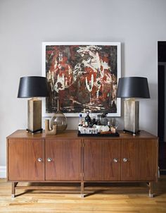 See more images from ron marvin: dark colors reinvent a one bedroom apartment on domino.com