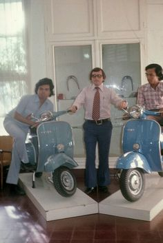Three men posing with two Vespa scooters in their factory owned by PT Dan Motor Indonesia, about Vespa Ape, Piaggio Vespa, Lambretta Scooter, Vespa Scooters, Scooter Garage, Scooter Bike, Vespa Sprint Veloce, Classic Vespa, Honda Ruckus