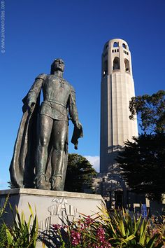 Statue of Christopher Columbus and Coit Tower atop Telegraph Hill in San Francisco