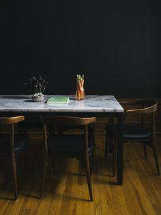 Marble tabletop. 60s chairs. And a jar of carrots.