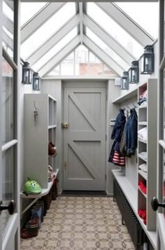 Use outdoor wall lights in your mudroom to transition from outdoor to indoor. Photo credit: Transitional Entry by London Interior Designers & Decorators Charlotte Crosland Interiors Porch Extension, House Extension Design, Side Extension, Extension Ideas, House Design, Entrance Design, House Entrance, Entrance Hall, Storage Room Organization