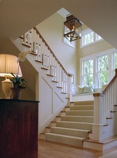 love the bench seat idea on the landing - Extra wide staircase with triple windows and bench at landing