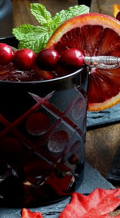 Halloween, holiday fun recipe: Bloody Zombie Rum Cocktail ~ It's a Graveyard Smash! ~ Created from the classic tropical Zombie Cocktail but with an autumnal and bloody twist. Blood orange, cranberry and pomegranate juices along with blood orange liqueur make for a euphoric rum sip. Your party guests will rave!   holiday cocktail recipe