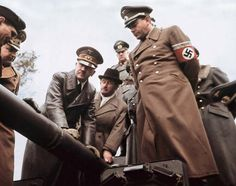 Adolf Hitler and his favourite architect Albert Speer, the Reichsminister for Armaments & War Production (Organisation Todt) examine munitions production.