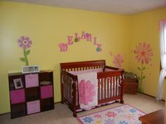 pink and yellow baby room. I like this for a little girls room! I also love the cherry wood color. I think that's what we'll get. :)