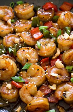 Super Easy Kung Pao Shrimp- used chicken (cooked it first - marinated in a little garlic and sesame oil) and shrimp - use less soy sauce and add chili sauce to cut salt if needed. - used tons of red and green peppers and lots of peanuts; served over lo mein noodles