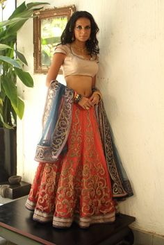 orange and blue lengha, show stopping guest wear