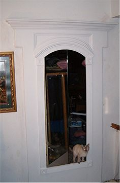 Hidden door behind a mirror...great way to add some mystery to your home!