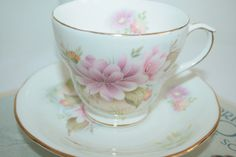 Vintage teacup and saucer with flowers in warm door HomiArticles