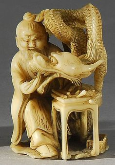 Lot 59: IVORY NETSUKE By Komin. Depicting a seated sennin feeding a dragon. Signed. - Eldred's | Invaluable