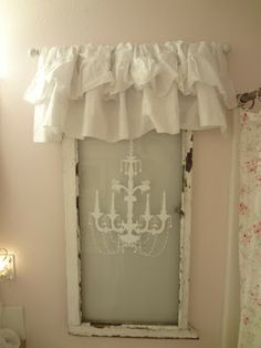 Cute idea to put a curtain on an old window and vinyl decal