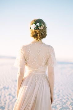 We adore how this lace shrug pairs with this blush dress.