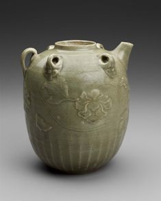 Ewer Vietnam, Tran-Le dynasty, 14th–15th century Stoneware with celadon glaze, molded, carved and applied decoration, molded and applied spout and handles, 25.4 x 16.3 MFA, 1991.981