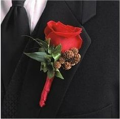 winter wedding red rose with pine cones for the groom