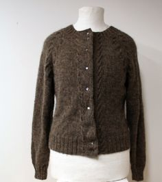 cardigan with raglan sleeves, knitting pattern from the Swedish Filtmakeriet that produces wool products such as yarn, needlefelted wool and other woolly things of Swedish rare sheep breeds. This one made of a blend that consists of the sheep´s natural colors: brown Finnsheep and grey Gotland sheep.