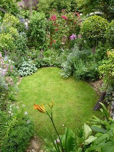 This looks like the most peaceful place on earth. garden design idea for a small garden, I love all the different plants and flowers