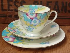 Doulton deco: Oban tea trio, V1495, c1936 (9). Vibrant pink and blue flowers offset by foliage and shading effects, including floral motifs to inner rims, and gold gilt bands, highlights and trim.