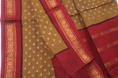 Sungudi block print from Madurai, is the durable everyday wear sari of the woman in Tamil Nadu!. Washes up very soft and drapey. Created with block printing, tie and dye and wax resist, making cracquelure texture in the ornament.