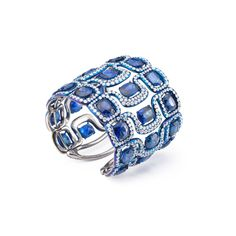 A large blued titanium cuff set with diamonds and sapphires created by Glenn Spiro.