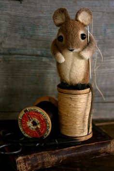 Little Cutie...Susan Pilotto is a mixed-media artist who specializes in creating one of a kind miniature animals from recycled wool felt fabric.