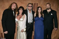 barry gibb and his family   Family: Barry (centre) and his wife Linda (centre left) pose with ...