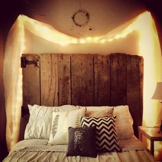 Reclaimed gate as headboard?  Kinda cool.  I really like the lighting idea.  Not as much as I like the sconces idea, though, but this would allow for moving the furniture around instead of forcing the bed to always stay in one place.