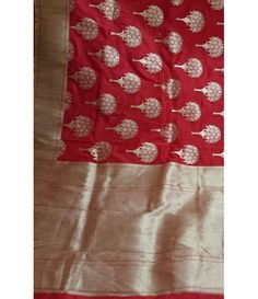 Red Pure Handloom Banarasi Katan Mina Work Saree-------Banarasi sarees are among the finest sarees in India and are known for their gold and silver brocade or zari, fine silk and opulent embroidery. The sarees are made of finely woven silk and are decorated with intricate design, and, because of these engravings, are relatively heavy. . A bride's trousseau is said to be incomplete without a Banarasi silk saree.----Sarees from luxurionworld.com