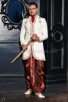 Sherwani Suits - Ivory brocade silk fusion sherwani with red cravat and a traditional dhoti
