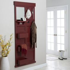 Perfect entryway piece for a narrow space (like behind my front door where I have about 9 inches). Fun diy using an old door.