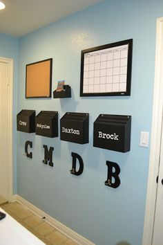 Inspiration Organization: Kids Command Center - I love the idea of putting an initial for each child so they know where their stuff goes!!