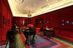 In her jewelry, designer Solange Azagury-Partridge has a flair for the dramatic. Same goes for her taste in interior decor as displayed in her Rodeo Drive boutique. The walls are lined in plush burgundy velvet, display cases come in velvet, too, and the designer's signature rainbow carpeting lines the floor.
