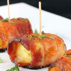 Sriracha-Honey Glazed Bacon-Wrapped Pineapple Recipe Appetizers with fresh pineapple, thick-cut bacon, pineapple, brown sugar, honey, lime, Sriracha, soy sauce, cilantro stems, cilantro leaves