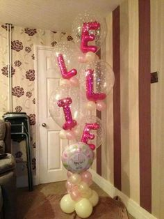 Spell out names using clear balloons and arrange in columns Balloon Inside Balloon, Name Balloons, Clear Balloons, Bubble Balloons, Love Balloon, Balloon Flowers, Balloon Columns, Helium Balloons, Baby Shower Balloons