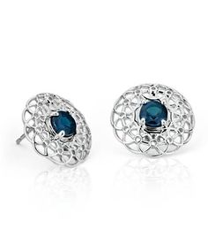 Intense medium dark blue round sapphires nestle in an intricately woven sterling silver halo giving these earrings a delicate, lacy look.
