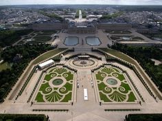 Aerial view of the Palace of Versailles and its gardens in France with the Parterre de Latone et the Parterre d'Eau.