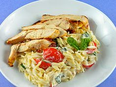 orzo with chicken and lemon : (serves 2-3)1 lg chicken breast, orzo, sour cream, parmesan cheese, garlic, lemon juice & zest,  olive oil, grape tomatoes, basil leaves