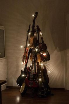 Guitar Christmas Tree...my boys would love.  Except they would keep taking it apart to play those instruments.  And since the banjo is on the bottom, it would be apart all the time!!