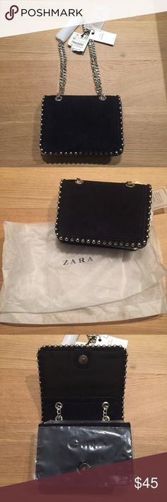 NEW Zara bag Brand new Zara bag with tags and comes with gift bag too. Has a silver chain. Black suede leather according to the tag. It was gift but not my style. I can't fully tell if it's dark dark navy or black but 99% it's black. I'll try to find the link online. Zara Bags Mini Bags