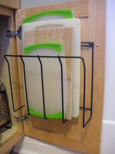 get two of those under-cabinet shelves, use one to store cutting boards!!