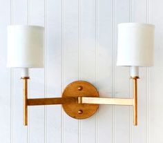 clean double sconce has a timeless feel. could be midcentury but could be traditional!