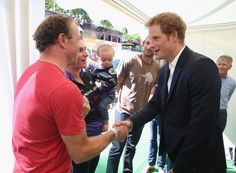 Prince Harry chats to Sarah Storey, her husband Barney and daughter Louise (aged 1) at the finish line of Stage 1 of the Tour De France on July 5, 2014