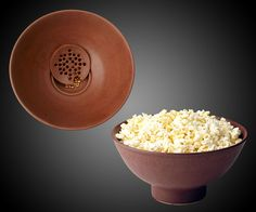 While I'm pretty sure this would be the most expensive popcorn bowl--and maybe bowl period--you'd ever own, if you are a popcorn fiend, or a Sesame Street-style Popcorn Monster, you might like a $75 popped corn receptacle with fancy built-in kernel si