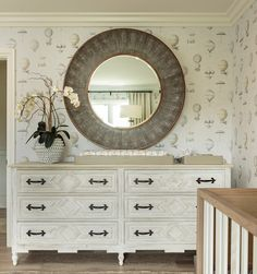 HGTV invites you to take a look at this celebrity baby nursery with a neutral distressed dresser, large round mirror and diaper changing dresser topper. Large Round Mirror, Round Mirrors, Steampunk Wallpaper, Changing Dresser, Distressed Dresser, Nursery Dresser, Dark Furniture, Nursery Neutral, Nursery Gray