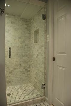 The basket weave marble tile floor and marble subway tile walls are both from Lowes.