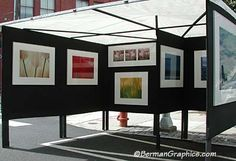 It's unusual to see black panels, but it really works behind these simple, colorful photos!  Gary San Pietro's art show booth